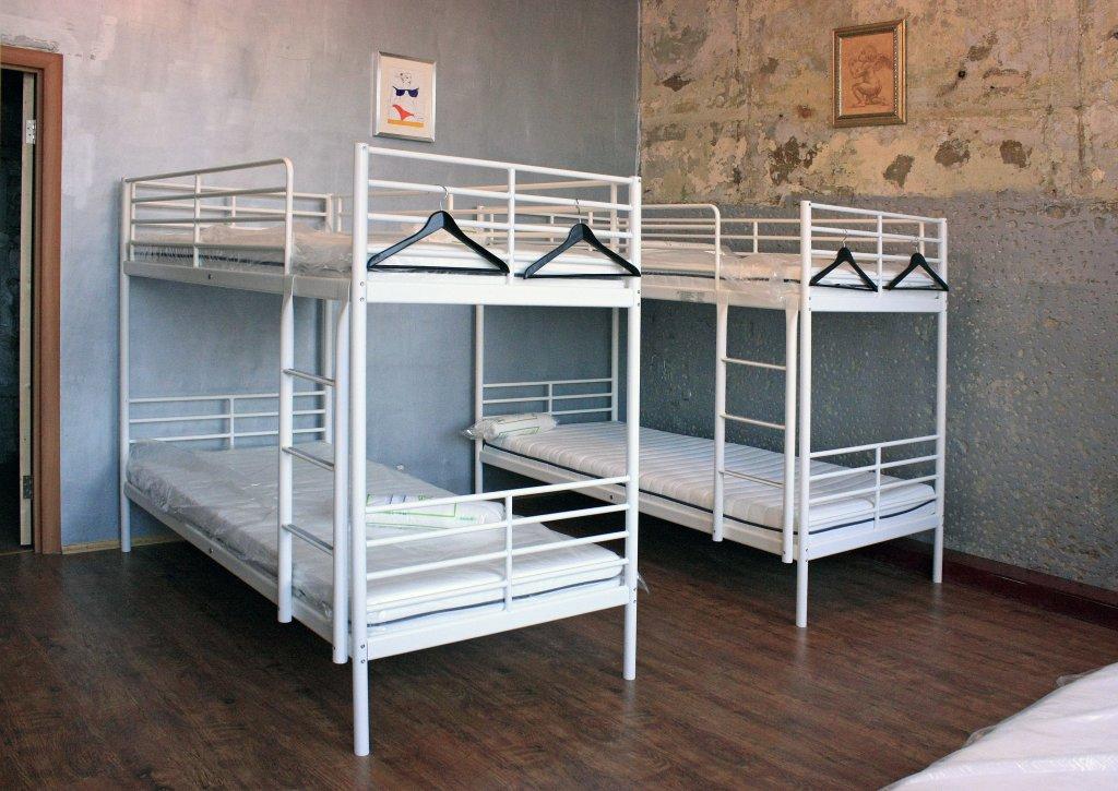 Хостел Типография Кровати в общем номере