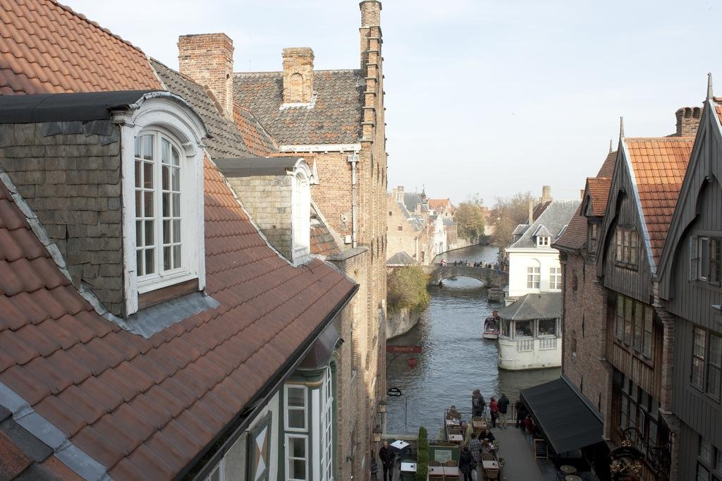 the historic centre of brugge Brugge is an outstanding example of a medieval historic settlement, which has maintained its historic fabric as this has evolved over the centuries, and where original gothic constructions form.