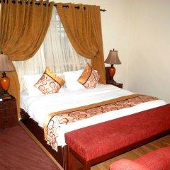 Отель Grand Inn & Suites комната для гостей фото 3