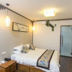 Manxin Hotel комната для гостей фото 2