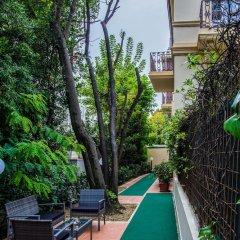 Отель Marina Centro Suite Римини бассейн