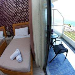 Отель ALER Holiday Inn Албания, Саранда - отзывы, цены и фото номеров - забронировать отель ALER Holiday Inn онлайн балкон