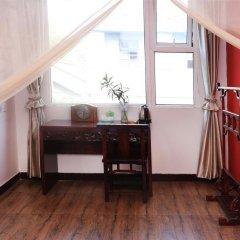 Отель Alley Youth Hostel Китай, Сиань - отзывы, цены и фото номеров - забронировать отель Alley Youth Hostel онлайн удобства в номере фото 2