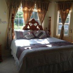 Отель Cazwin Villas Ямайка, Монтего-Бей - отзывы, цены и фото номеров - забронировать отель Cazwin Villas онлайн комната для гостей
