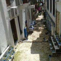 Отель Old Kalamaki Pansiyon Калкан приотельная территория