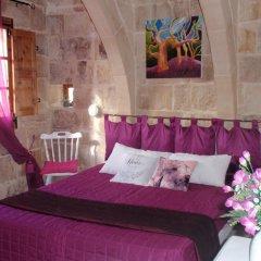Отель Vittoria Suites комната для гостей