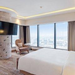 Radisson Blu Olympiyskiy Hotel Москва комната для гостей фото 10