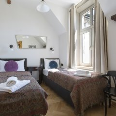 Апартаменты Antique Apartments Plac Szczepanski Краков комната для гостей фото 4