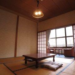 Отель Yamanoyado Reisen Kannojigoku Ryokan Минамиогуни комната для гостей фото 2
