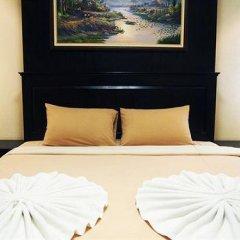 Апартаменты At Home Executive Apartment Паттайя комната для гостей фото 3