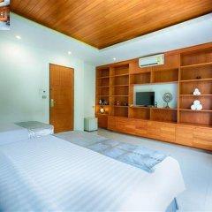 Escape De Phuket Hotel & Villa сейф в номере
