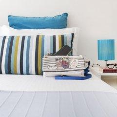 Отель Beachouse - Surf, Bed & Breakfast сейф в номере