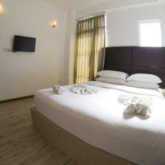 Отель Airport Comfort Inn Maldives Мале комната для гостей фото 3