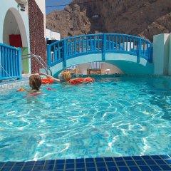 Отель Maria Mill Studios Греция, Остров Санторини - 1 отзыв об отеле, цены и фото номеров - забронировать отель Maria Mill Studios онлайн бассейн фото 2