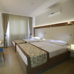 Almera Apart Hotel комната для гостей