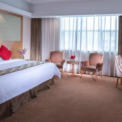 Vienna International Hotel комната для гостей