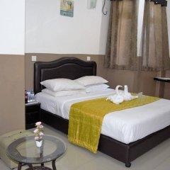 Отель Ashaz Inn комната для гостей фото 4