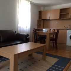Апартаменты Four Leaf Clover Apartments в номере