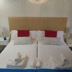 Отель Colon Suites Мадрид комната для гостей фото 2