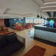Отель Adig Suites Нигерия, Энугу - отзывы, цены и фото номеров - забронировать отель Adig Suites онлайн гостиничный бар
