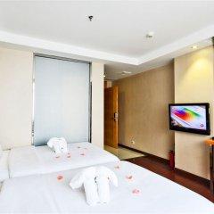 Апартаменты Dunhe Apartment комната для гостей