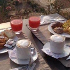 Отель Pamperduto Country Resort Потенца-Пичена питание