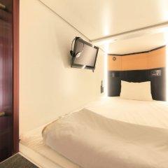 Отель Capsule and Sauna Oriental Япония, Токио - отзывы, цены и фото номеров - забронировать отель Capsule and Sauna Oriental онлайн сейф в номере