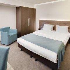 Отель Holiday Inn Düsseldorf - Hafen сейф в номере