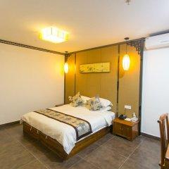 Manxin Hotel комната для гостей фото 4