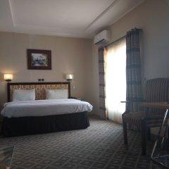 Отель Adig Suites Нигерия, Энугу - отзывы, цены и фото номеров - забронировать отель Adig Suites онлайн комната для гостей фото 5