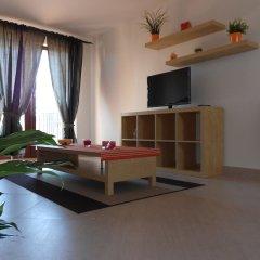 Апартаменты Apartments u Staropramenu комната для гостей фото 3