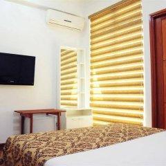 Отель HolidayMakers Inn Мальдивы, Северный атолл Мале - отзывы, цены и фото номеров - забронировать отель HolidayMakers Inn онлайн удобства в номере