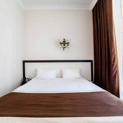 Корона отель-апартаменты комната для гостей