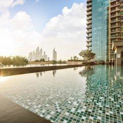 Отель One Perfect Stay 2BR at Fairways бассейн