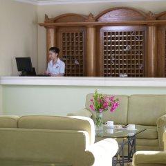 Отель Mitsis Family Village Beach Hotel Греция, Нисирос - отзывы, цены и фото номеров - забронировать отель Mitsis Family Village Beach Hotel онлайн интерьер отеля