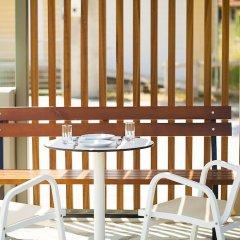 Отель Enalia Villas гостиничный бар