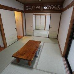 Отель Minshuku Takesugi Якусима комната для гостей