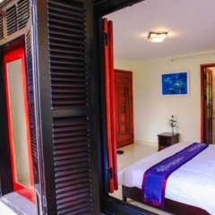 Отель Harmony Homestay сейф в номере