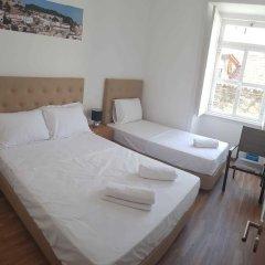 Отель Perola Dos Anjos Лиссабон комната для гостей