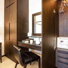 Отель Anon Villa сейф в номере