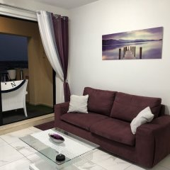 Апартаменты Marsascala Sea View Luxury Apartment & Penthouse Марсаскала комната для гостей фото 2