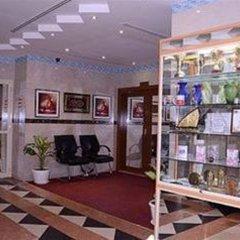 Отель Burj Al Diyar Hotel Apartments ОАЭ, Шарджа - отзывы, цены и фото номеров - забронировать отель Burj Al Diyar Hotel Apartments онлайн интерьер отеля