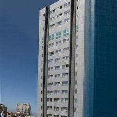 Отель Metropolitan Suites Тель-Авив бассейн