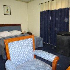 Отель ED Scob Suites Limited сейф в номере