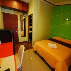 Отель The Palm Delight Guesthouse удобства в номере