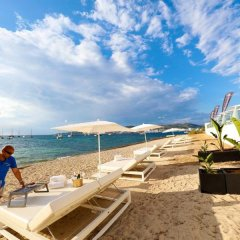 Апартаменты AxelBeach Ibiza Suites Apartments Spa and Beach Club - Adults Only пляж фото 2