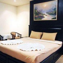 Апартаменты At Home Executive Apartment Паттайя комната для гостей фото 5