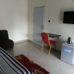 Отель Queen Idia Suites удобства в номере