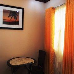 Отель Cambriza Suites удобства в номере