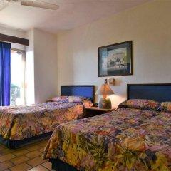 Hotel Suites del Sol Пуэрто-Вальярта комната для гостей